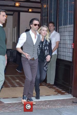 Kate Winslet , Ned Rocknroll - Kate Winslet and her husband Ned Rocknroll leave their Manhattan hotel - New York...