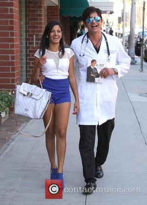 Dr Robert Rey - Dr Robert Rey holds up a copy of his new book whilst out in Beverly Hills...