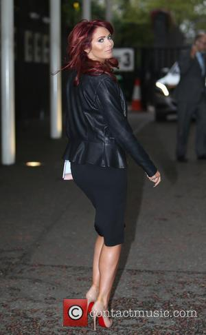 Amy Childs - Amy Childs outside ITV Studios, holding a copy of her new book '100% Me'. - London, United...