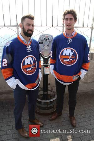 Nick Leddy , Brock Nelson - Islanders players Brock Nelson and Nick Leddy light The Empire State Building in celebration...