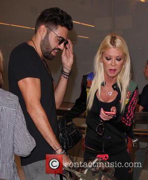 Tara Reid , Yavuz Cansiz - Tara Reid arrives at Los Angeles International Airport (LAX) - Los Angeles, California, United...