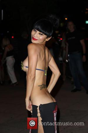 Bai Ling - Bai Ling arrives at the premiere of 'Samurai Cop 2' wearing a bikini top made of police...