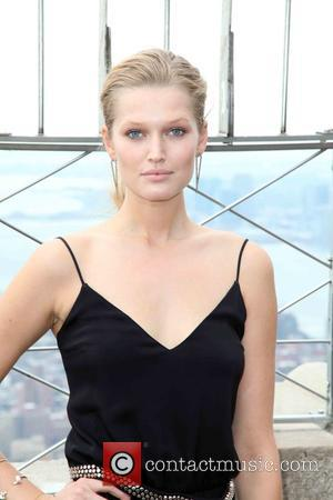 Toni Garrn - Toni Garrn lights the Empire State Building for Plan International USA in honor of International Day of...