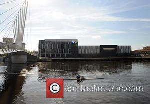 Rowers at Media City By Coronation Street Studio' - A beautiful sunny day in Media City Manchester. People seen sat...