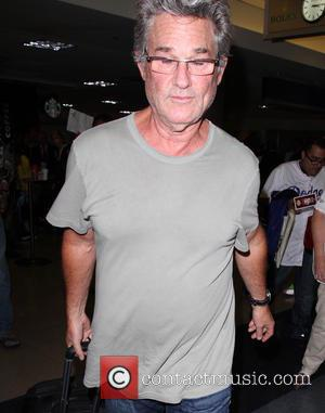Kurt Russell - Kurt Russell arrives at Los Angeles International Airport (LAX) - Los Angeles, California, United States - Saturday...