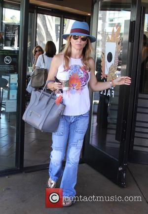 lori loughlin - Lori Loughlin picks up a coffee from Starbucks at beverly hills - Beverly Hills, California, United States...