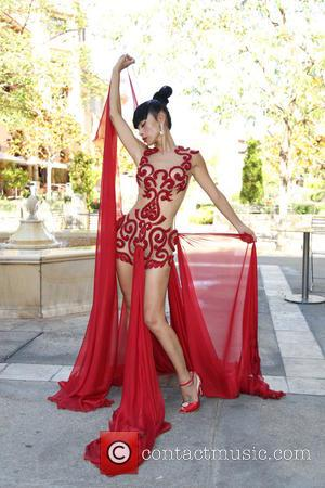 Bai Ling - Bai Ling poses on the streets of Beverly Hills in a red and nude sheer dress as...