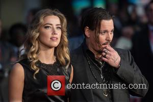 Amber Heard , Johnny Depp - BFI LFF: Black Mass gala screening held at the Odeon Leicester Square - Arrivals....