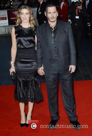 Johnny Depp , Amber Heard - BFI London Film Festival - 'Black Mass' - Premiere - London, United Kingdom -...