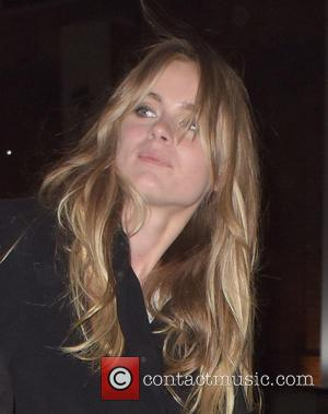 Cressida Bonas - Cressida Bonas and a young man exchange confused looks while leaving the Chanel Mademoiselle Prive party at...