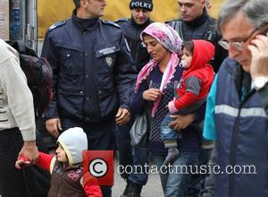Bulgaria Syrian Refugees - Bulgarian police and border police guard illegal Syrian refugees, found in a truck, in the Black...