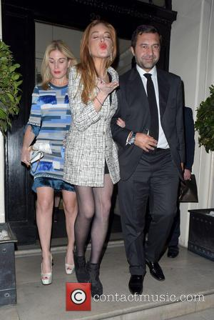 Lindsay Lohan - Lindsay Lohan with laddered tights at Mortons Club Berkerley square - London, United Kingdom - Tuesday 13th...