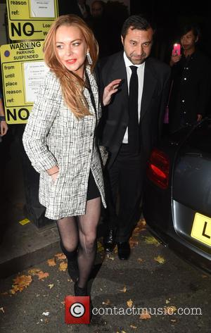 Lindsay Lohan - Lindsay Lohan leaves Morton's private members club in London with a male companion - London, United Kingdom...