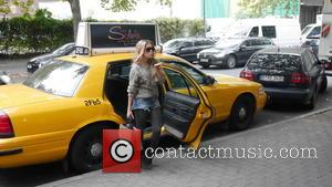 Sylvie Meis , Sylvie van der Vaart - Sylvie Meis posing at a New York style cab whilst leaving Parker...