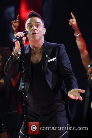 Robbie Williams 'Heading Back Into The Studio With Take That'