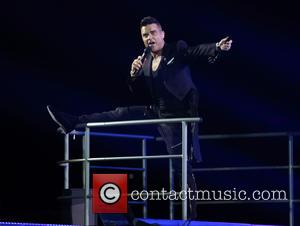 Robbie Williams - Robbie Williams performing live in concert at the Adelaide Entertainment Centre - Adelaide, Australia - Wednesday 14th...
