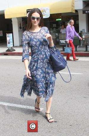 Emmy Rossum - Emmy Rossum goes to a salon in Beverly Hills as her blue floral dress catches the wind...