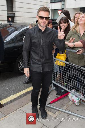 Gary Barlow , Take That - Take That pictured arriving at the Radio 2 studio at BBC Western House -...