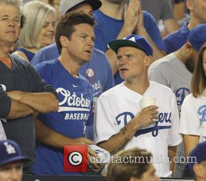 Jason Bateman , Flea - Celebrities watch Game 5 of the National League Division Series. The New Your Mets defeated...