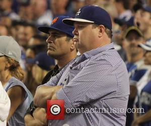 Eric Stonestreet , Ty Burrell - Celebrities watch Game 5 of the National League Division Series. The New Your Mets...