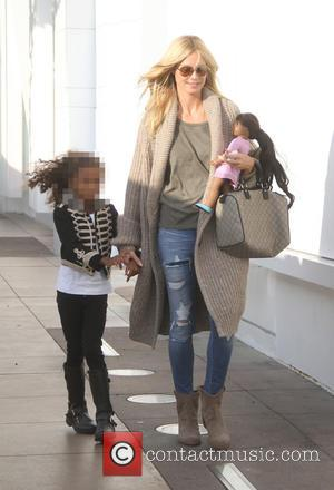 Heidi Klum , Lou Sulola Samuel - Heidi Klum her daughter shopping at The Grove in Hollywood - Los Angeles,...