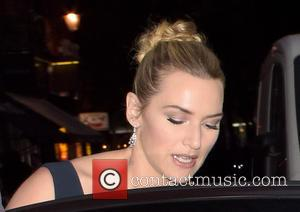 Kate Winslet - Kate Winslet leaves her hotel with family and friends for the 'Steve Jobs' premiere - London, United...