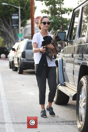 Cara Santana - Cara Santana leaving the Verve cafe in West Hollywood carrying her dog in her arms at Verve...