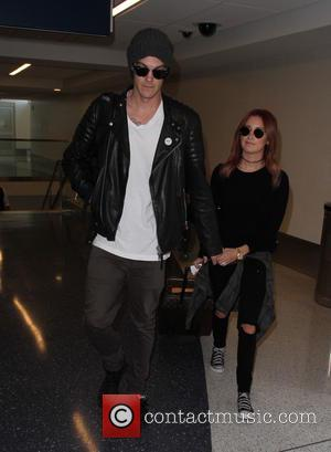 Ashley Tisdale , Christopher French - Ashley Tisdale departs from Los Angeles International Airport with husband Christopher French - Los...