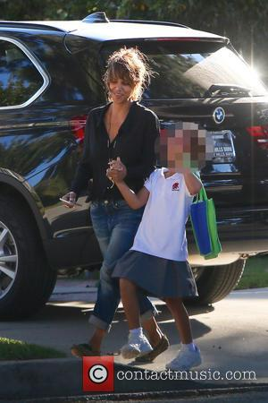 Halle Berry , Nahla Aubry - Halle Berry laughs as she shares a joke with daughter Nahla seen out and...