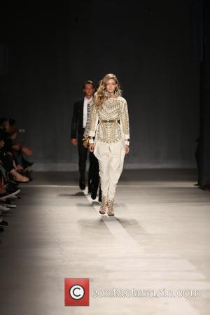 Gigi Hadid - The BALMAIN X H&M Collection Launch at 23 Wall Street - Runway - New York, New York,...