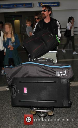 Christian Bale , Emmeline Bale - Christian Bale and family arrive on a flight to Los Angeles International Airport (LAX)...