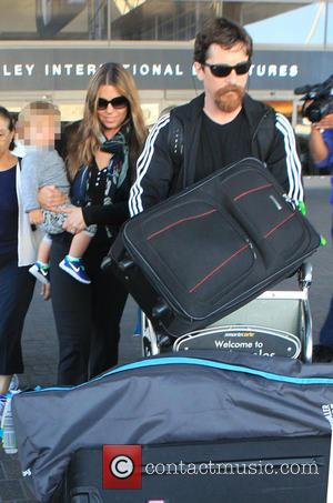 Christian Bale, Joseph Bale , Sibi Blazic - Christian Bale and family arrive on a flight to Los Angeles International...