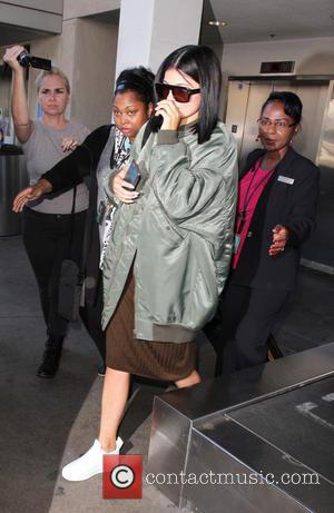 Kylie Jenner - Kendall and Kylie Jenner at Los Angeles International Airport (LAX) - Los Angeles, California, United States -...