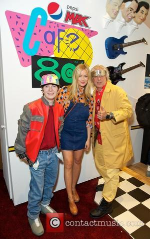 Laura Whitmore, Marty Mcfly , Doc Brown lookalikes - Also in attendance was television personality Laura Whitmore, who posed with...