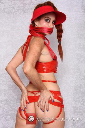 Phoebe Price - Phoebe Price wears an outfit made entirely of red tape during a 'Fifty Shades of Duct Tape'...