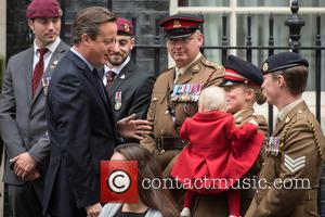 David Cameron, Private Jodie Older , Isabella Older - National Poppy Appeal 2015 launch and photocall held at 10 Downing...