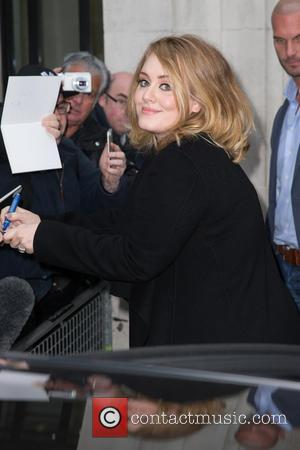 Adele Adkins - Adele pictured arriving at the Radio 2 studio to appear on the Chris Evans Breakfast Show to...
