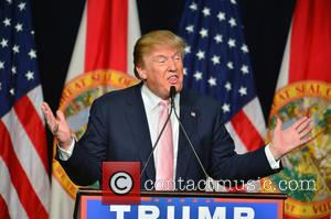 Donald Trump - Republican presidential hopeful Donald Trump speaks at a campaign rally at the Trump National Doral Miami at...