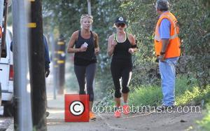 Reese Witherspoon - Reese Witherspoon out jogging in Brentwood with a friend - Los Angeles, California, United States - Friday...