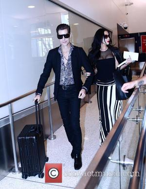 Perry Farrell , Etty Lau Farrell - Perry Farrell and his wife Etty Lau depart from Los Angeles International Airport...
