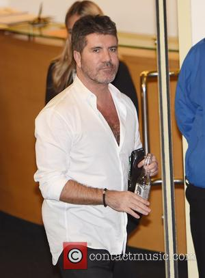 Simon Cowell - Simon Cowell leaving Fountain studios after filming the first live part of the X Factor. at x...
