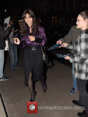 Monica Bellucci - Monica Bellucci signs autographs for fans as she arrives at a hotel - LONDON, United Kingdom -...