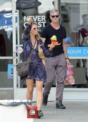 Rebecca Gayheart , Eric Dane - Actress Rebecca Gayheart enjoys a sunday afternoon with husband Eric Dane and their 2...