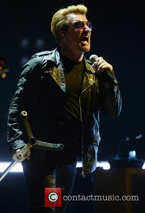 U2 , Bono - U2 perform live in concert during the 'iNNOCENCE + eXPERIENCE Tour' at the The O2 at...