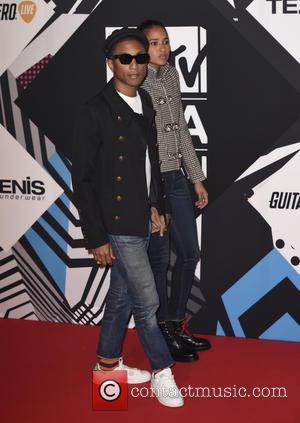 Pharrell Williams , Helen Lasichanh - The 2015 MTV EMAs (European Music Awards) held at the Mediolanum Forum in Milan...