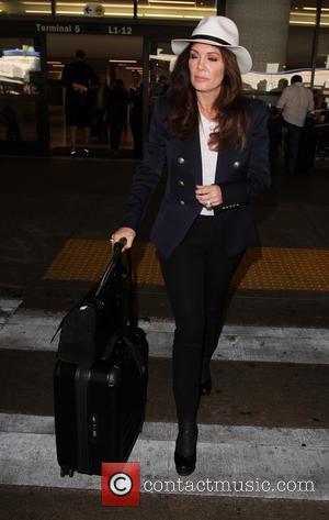 Lisa Vanderpump - Lisa Vanderpump arrives on a flight to Los Angeles International Airport (LAX) - Los Angeles, California, United...