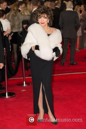 Joan Collins - CTBF Royal Film Performance(TM) 2015, the World Premiere of 'Spectre' - Arrivals at The Royal Albert Hall...