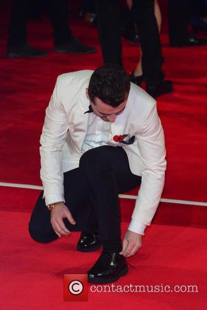 Sam Smith , shoe malfuntion - Royal world premiere of 'Spectre' at Royal Albert Hall - Red Carpet Arrivals at...