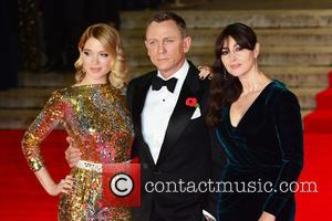 Lea Seydoux, Daniel Craig , Monica Bellucci - Royal film performance of 'Spectre' at Royal Albert Hall - Red Carpet...