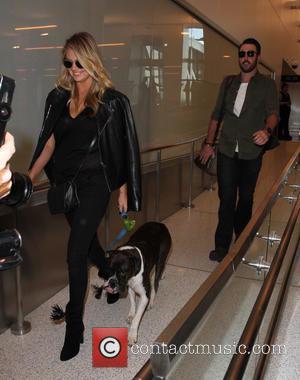 Kate Upton , Justin Verlander - Kate Upton departs on a flight from Los Angeles International Airport (LAX) - Los...